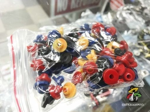 Photo of a plastic bag full of A-Bar Rubber Grommets for Tattoo Machines.