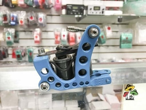 Photo of a baby blue tattoo machine.