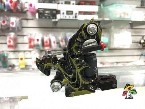 Photo of a black and yellow tattoo machine.