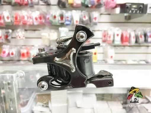 Photo of a black and silver tattoo machine.